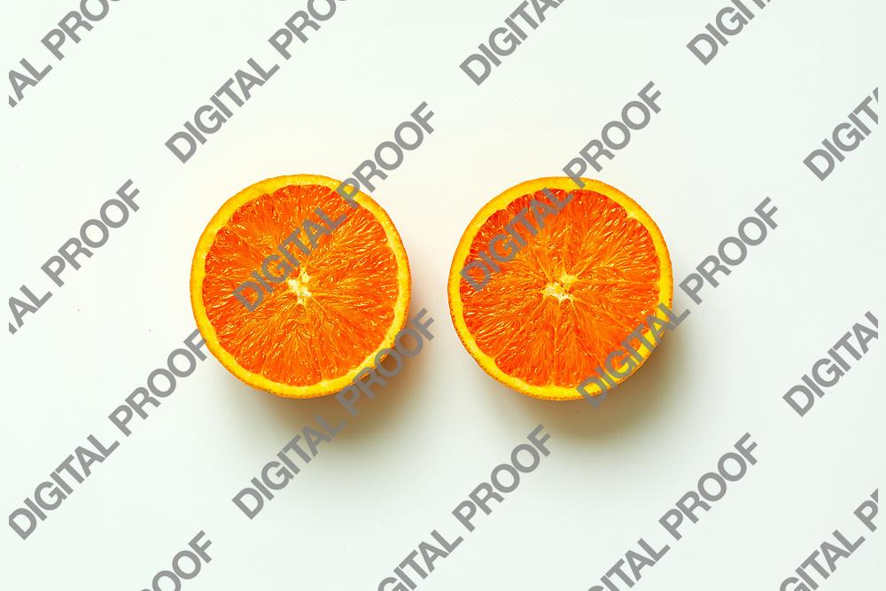 Orange fruit. Orange half fruit sliced isolate on white background seen from above flatlay style, close up.