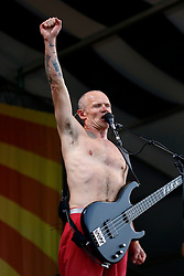 24 April 2016. New Orleans, Louisiana.<br /> The New Orleans Jazz and Heritage Festival. <br /> Flea of the Red Hot Chill Peppers headlining the Acura Stage.<br /> Photo; Charlie Varley/varleypix.com