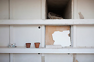 Lampedusa, Italia - Il cimitero dell'isola di Lampedusa. Accanto agli isolani riposano anche i migranti deceduti nel tentativo di raggiungere l'isola. Le tombe dei migranti sono spesso senza nome e identificabili attraverso dei numeri scritti sulle croci. <br /> Ph. Roberto Salomone