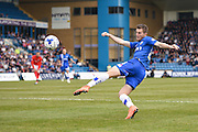 Gillingham forward Ben Dickenson takes a shot at goal early in the match during the Sky Bet League 1 match between Gillingham and Coventry City at the MEMS Priestfield Stadium, Gillingham, England on 2 April 2016. Photo by David Charbit.