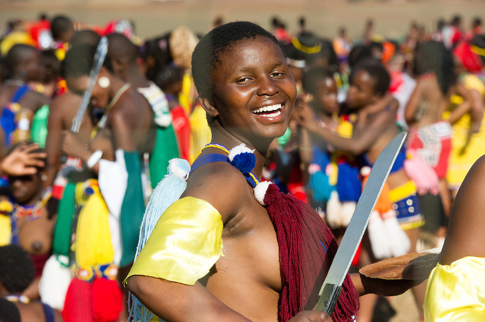 Ludzidzini, Swaziland, Africa - Annual Umhlanga, or reed dance ceremony, in which up to 100,000 young Swazi women gather to celebrate their virginity and honor the queen mother during the 8 day long event.<br /> Maidens prepare to dance before King Mswati III on day 7 of the ceremony