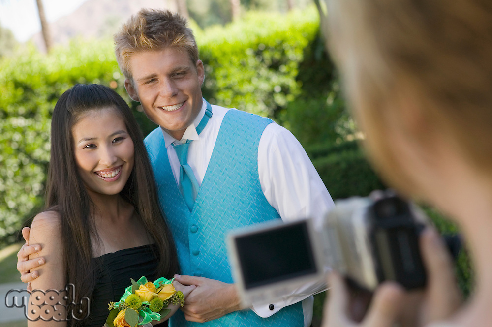 Smiling Prom Couple Being Videotaped