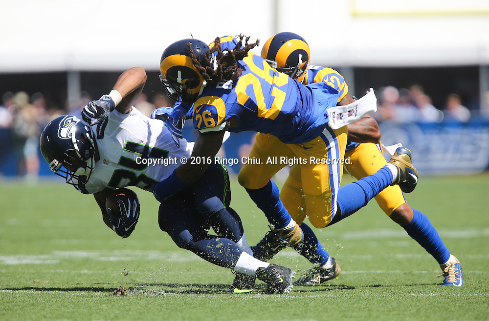 Seattle Seahawks running back Thomas Rawls (34) is tackled by Los Angeles Rams linebacker Mark Barron (26) during a NFL football game, Sunday, Sept. 18, 2016, in Los Angeles. The Rams won 9-3.(Photo by Ringo Chiu/PHOTOFORMULA.com)<br /> <br /> Usage Notes: This content is intended for editorial use only. For other uses, additional clearances may be required.