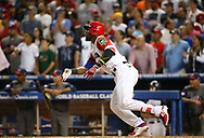 March 11, 2017 - Miami, FL, USA - The Dominican Republic's Starling Marte hits a solo home run during the eighth inning against the United States in a World Baseball Classic first round Pool C game at Marlins Park in Miami on Saturday, March 11, 2017. The Dominican Republic won, 7-5. (Credit Image: © David Santiago/TNS via ZUMA Wire)