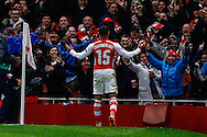 Alex Oxlade-Chamberlain of Arsenal celebrates scoring his team's third goal against R.S.C Anderlecht to make it 3-0 during the UEFA Champions League match at the Emirates Stadium, London<br /> Picture by David Horn/Focus Images Ltd +44 7545 970036<br /> 04/11/2014