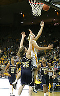28 NOVEMBER 2007: Iowa forward Krista VandeVenter (51) drives to the basket while being guarded by Georgia Tech forward Brigitte Ardossi (35) in the first half of Georgia Tech's 76-57 win over Iowa in the Big Ten/ACC Challenge at Carver-Hawkeye Arena in Iowa City, Iowa on November 28, 2007.