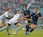 Twickenham. UK.   Oxford's, Alexander MACDONALD driving through Nick JONES tackle during the  2013 Varsity Rugby Match, defeating Cambridge 33 - 15 on    Thursday  12/12/2013, at the RFU Stadium.  Surrey, England  [Mandatory Credit. Peter Spurrier/Intersport Images]