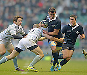 Twickenham. UK.   Oxford's, Alexander MACDONALD driving through Nick JONES tackle during the  2013 Varsity Rugby Match, defeating Cambridge 33 - 15 on    Thursday  12/12/2013, at the RFU Stadium.  Surrey, England  [Mandatory Credit. Peter Spurrier/Intersport Images]