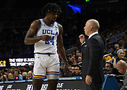Nov 6, 2019; Los Angeles, CA, USA; UCLA Bruins head coach Mick Cronin talks with forward Jalen Hill (24) n the second half against  Long Beach State at Pauley Pavilion. UCLA defeated Long Beach State 69-65 in Cronin's first game as UCLA coach.