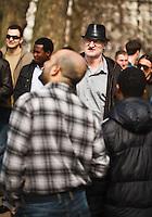 A man heckles a speaker at Speaker's Corner in Hyde Park, London, England.