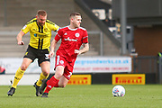 Accrington Stanley forward Billy Kee (29) marked by Burton Albion defender Jake Buxton (3) during the EFL Sky Bet League 1 match between Burton Albion and Accrington Stanley at the Pirelli Stadium, Burton upon Trent, England on 23 March 2019.