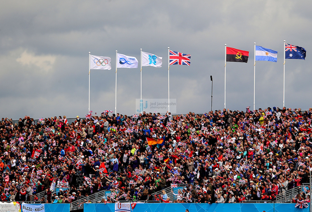 Fans look on from the grandstands during the canoe sprint at Eton Dorney during day 11 of the London Olympic Games in London, England, United Kingdom on August 7, 2012..(Jed Jacobsohn/for The New York Times)..