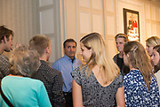 Pete Souza talks with guests before the start of the President's Reception in Chaddock Alumni Room on September 19, 2017.