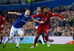 LIVERPOOL, ENGLAND - Sunday, March 3, 2019: Everton's captain Seamus Coleman (L) and Liverpool's Divock Origi during the FA Premier League match between Everton FC and Liverpool FC, the 233rd Merseyside Derby, at Goodison Park. (Pic by Laura Malkin/Propaganda)