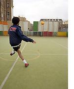Young man kicking a football.