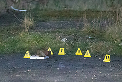 © Licensed to London News Pictures . 29/12/2018 . Wigan , UK . Police forensic markers by bricks and rocks at the scene where they have taped off a stretch of Bickershaw Lane in Abram . Greater Manchester Police have launched a murder investigation after 21-year-old Wiliam Livesley (known as Billy ) was murdered yesterday evening (Friday 28th December 2018) . Photo credit : Joel Goodman/LNP