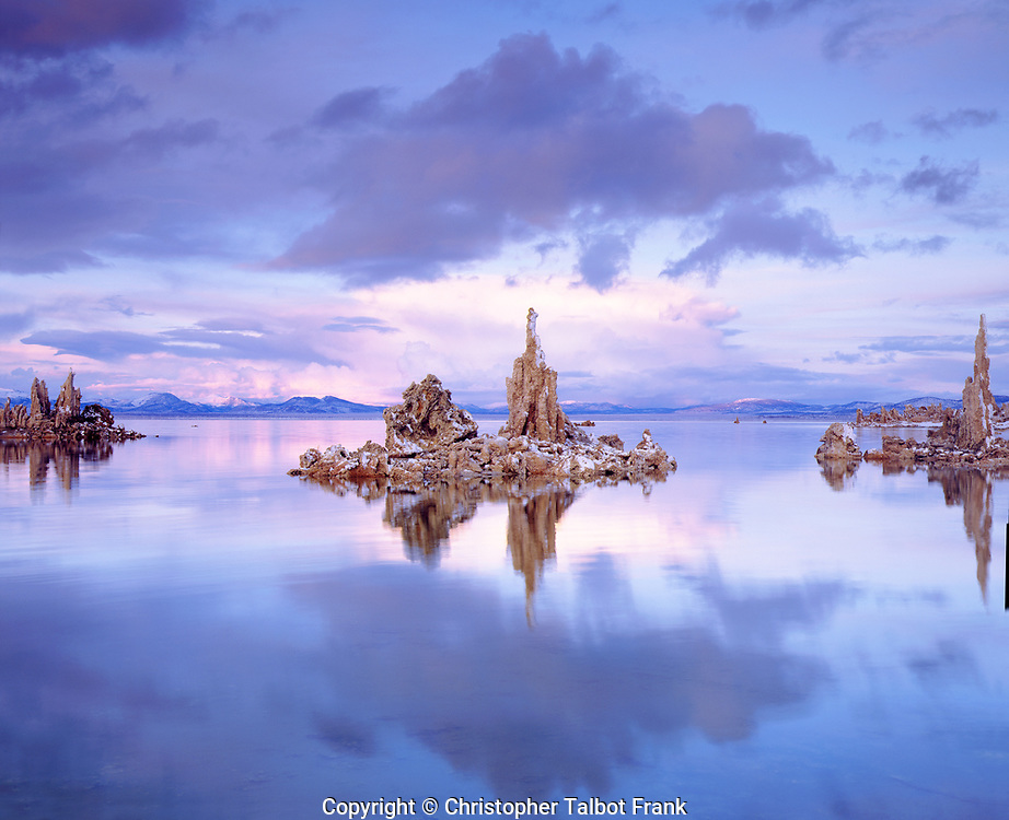 Pastel colors and fresh snow make my photo of tufa formations reflecting in Mono Lake quite interesting.  This subtile mirror image of this surreal landscape shows the the Sierra Nevada Mountains on the horizon.