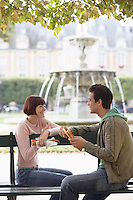 Couple Eating Baguettes in Park