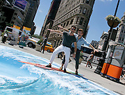 Nate Burkus and Jeremiah Brent ride a wave during #VisitAnaheim in 3D event in the Flatiron District in New York City, New York on June 24, 2015.