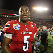 Louisville Cardinals quarterback Teddy Bridgewater (5) celebrates on the field after the NCAA Football Russell Athletic Bowl football game between the Louisville Cardinals and the Miami Hurricanes, at the Florida Citrus Bowl on Saturday, December 28, 2013 in Orlando, Florida. Louisville won the game by a score of 36-9. (AP Photo/Alex Menendez)