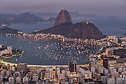 Sugarloaf Mountain and Guanabara Bay from Mirante Dona Marta in twilight in Rio de Janeiro, Brazil.