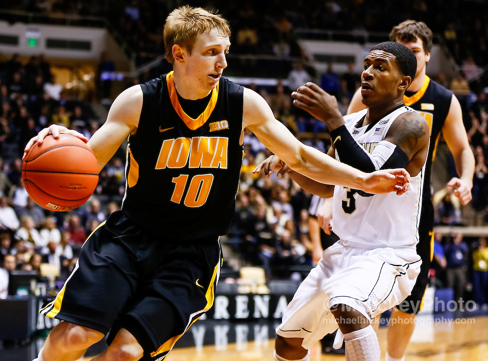 WEST LAFAYETTE, IN - JANUARY 27: Mike Gesell #10 of the Iowa Hawkeyes dribbles around Ronnie Johnson #3 of the Purdue Boilermakers at Mackey Arena on January 27, 2013 in West Lafayette, Indiana. Purdue defeated Iowa 65-62 in overtime. (Photo by Michael Hickey/Getty Images) *** Local Caption *** Mike Gesell; Ronnie Johnson