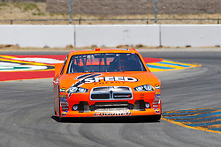 June 24, 2011; Sonoma, CA, USA;  NASCAR Sprint Cup Series driver Robby Gordon (7) drives through turn 7 during practice for the Toyota/Save Mart 350 at Infineon Raceway.