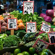 Fresh organic produce at  high stall, at the Pike Place Market, Seattle, Washington