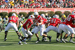 16 October 2010:  Matt Brown offers the ball to Erik Smith during a game where the North Dakota State Bison lost to the Illinois State Redbirds 34-24, meeting at Hancock Stadium on the campus of Illinois State University in Normal Illinois.