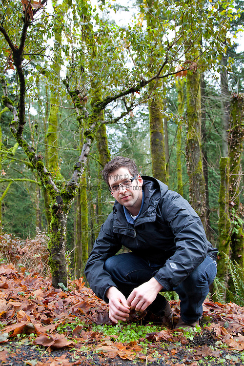 Castagna Chef, Matthew Lightner, foraging for wild greens from a forest in Portland, Oregon. Pictured here is wild cress.