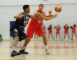 Bristol Flyers' Greg Streete is tackled by Leicester Riders Jamell Anderson - Photo mandatory by-line: Dougie Allward/JMP - Mobile: 07966 386802 - 13/03/2015 - SPORT - Basketball - Bristol - SGS Wise Campus - Bristol Flyers v Leicester Riders - British Basketball League