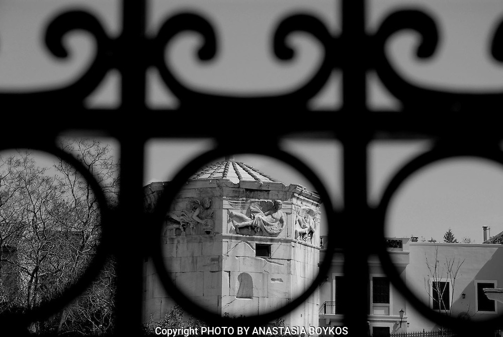 Frame your subject!!!<br /> <br /> Airs (monument).<br /> <br /> With Airs name established to be called ancient monument - building located in the northern foothills of the Acropolis of Athens , on the site of the Roman Forum in Plaka . This monument whose official name is Clock Tower of the Winds, considered that the erected by Andronicus Winds (or Kyrristos), hence the name. This octagonal marble building without columns, where the same number of fronts brought relief eight principal winds, hence airs.It has two doors, one to the north and one to the west.