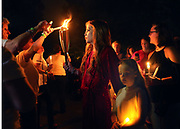 Elvis Presley's daughter Lisa Marie lit the candles of some of the mourners who gathered to commemorate the 40th anniversary of the death of singer Elvis Presley at his former home of Graceland, in Memphis, Tennessee, U.S. August 15, 2017. REUTERS/Karen Pulfer Focht