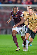 Uche Ikpeazu (#19) of Heart of Midlothian FC during the Betfred Scottish Football League Cup quarter final match between Heart of Midlothian FC and Aberdeen FC at Tynecastle Stadium, Edinburgh, Scotland on 25 September 2019.