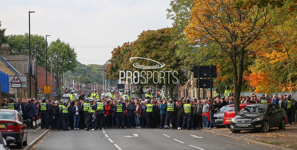 Sheffield United fans are held back by police after the EFL Sky Bet Championship match between Sheffield Wednesday and Sheffield Utd at Hillsborough, Sheffield, England on 24 September 2017. Photo by Phil Duncan.