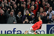 Cristiano Ronaldo celebrates scoring the second goal during the UEFA Champions League First Knockout Round Second Leg match between Manchester United and Inter Milan at Old Trafford on March 11 2009, in Manchester, England.