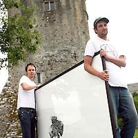 Matt Hearn and Jim Ricks gets a piece by Darren Banks ready to hang for the opening of the 3rd annual Lotus+ 'Opposite of Vertigo' art exhibition at the Burren College of Art on Friday.<br /><br /><br /><br />Photograph by Yvonne Vaughan.