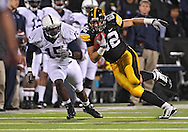 October 2 2010: Iowa Hawkeyes tight end Allen Reisner (82) tries to get around Penn State Nittany Lions linebacker Bani Gbadyu (15) during the first half of the NCAA football game between the Penn State Nittany Lions and the Iowa Hawkeyes at Kinnick Stadium in Iowa City, Iowa on Saturday October 2, 2010. Iowa defeated Penn State 24-3.