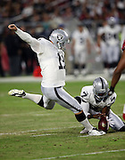 Oakland Raiders punter Marquette King (7) holds while Oakland Raiders kicker Sebastian Janikowski (11) kicks a 53 yard first quarter field goal that ties the score at 3-3 during the 2016 NFL preseason football game against the Arizona Cardinals on Friday, Aug. 12, 2016 in Glendale, Ariz. The Raiders won the game 31-10. (©Paul Anthony Spinelli)