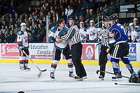 KELOWNA, CANADA - JANUARY 2:  Linesmen Dustin Minty and Ward Pateman part JT Barnett #17 of the Kelowna Rockets and Tyler Stahl #7 of the  Victoria Royals  after an on ice altercation at the Kelowna Rockets on January 2, 2013 at Prospera Place in Kelowna, British Columbia, Canada (Photo by Marissa Baecker/Shoot the Breeze) *** Local Caption ***