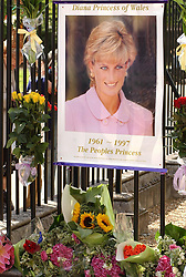A poster and flowers with cards tied  on the gates of Kensington Palace, London  on the aniversary of the death of Princess Diana who died 6 years ago in a car crash in Paris.