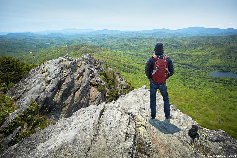 A hiker enjoys the view on the summit of Grandfather Mountain near the Blue RIdge Parkway of North Carolina