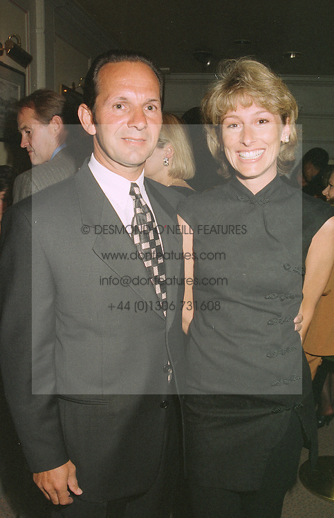 MR & MRS CHRIS BANKS, she owns the nightclub Raffles, at a party in London on April 16th 1997.LXS 14