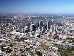 Aerial view of Houston, Texas with downtown skyline, surrounding neighborhoods, and the southwest freeway I-59.