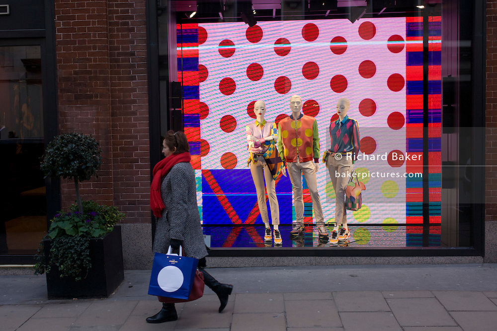 A spotty shopping bag and a window theme of dots in the window of Etro on Old Bond Street, central London.
