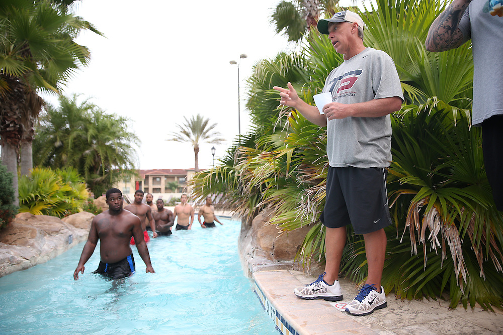 FEB  5 2014:  Coach Tom Shaw trains  football players for the NFL Scouting Combing at his facility at Disney's Wide World of Sports in Orlando, Florida. Photo by Tom Hauck.