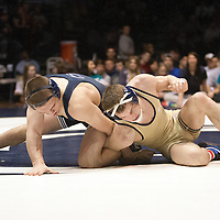 February 23, 2014; State College, PA, USA;  Penn State's Zain Retherford looks to escape from Clarion's Tyler Bedelyon in their 141-pound match at Rec Hall.  Retherford scored an 8-4 decision win and Penn State defeated Clarion 43-3.