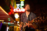 C.B. Horton plays to people on the street as he plays with his band, CBHorton's Mojo Circus at the Owl Club during the bar scene in old town Roseville Friday Feb. 10, 2012.