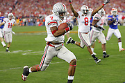 GLENDALE, AZ - JANUARY 8:  Ted Ginn, Jr. #7 of the Ohio State Buckeyes runs the opening kickoff back for a 93 yard touchdown and a 7-0 lead over the Florida Gators during the 2007 Tostitos BCS National Championship Game at the University of Phoenix Stadium on January 8, 2007 in Glendale, Arizona. The Gators defeated the Buckeyes 41-14. ©Paul Anthony Spinelli *** Local Caption *** Ted Ginn, Jr.