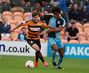 Barnet player Luke Gambin looks to get the better of Wycombe Wanderers player Sido Jombati during the Sky Bet League 2 match between Barnet and Wycombe Wanderers at The Hive Stadium, London, England on 15 August 2015. Photo by Bennett Dean.